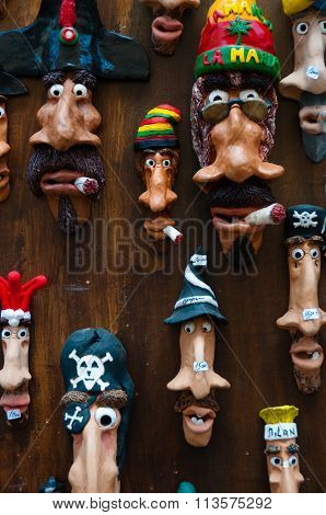 Funny handmade elongated faces art on wood wall