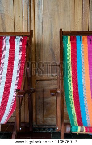 Colorful deck chair in front of a wooden door at hostel