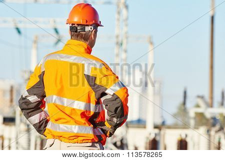 Service engineer standing at heat electropower station