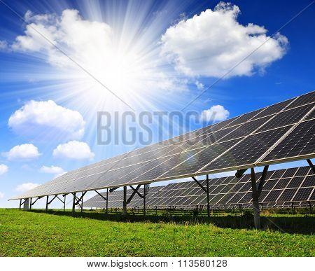 Solar panels against sunny sky.