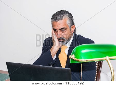 Businessman In A Suit And Tie, In His Studio.