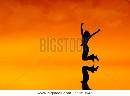 Silhouette of a woman jumping