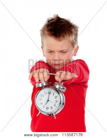 Angry little boy holding a clock isolated on white background