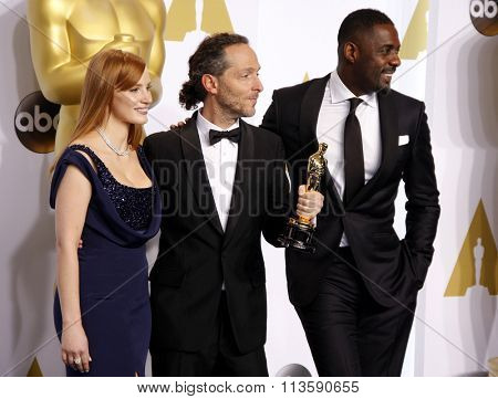 Emmanuel Lubezki, Jessica Chastain and Idris Elba at the 87th Annual Academy Awards - Press Room held at the Loews Hollywood Hotel in Los Angeles, USA February 22, 2015.