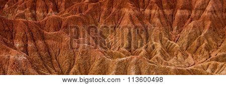 Detail of Drought red orange sand stone rock formation in Tatacoa desert, Huila