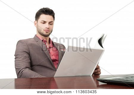 Business Man Reading A Magazine.