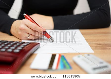 Woman Is Reading Bank Notice About Credit Card Spending And  Repayment Of Debt