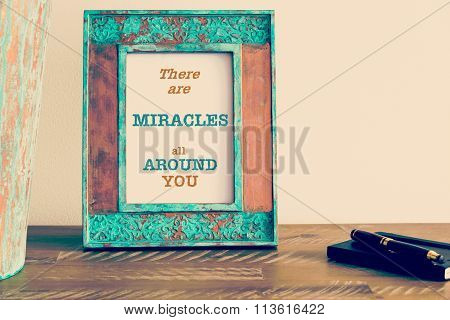 Motivational Quote Written On Vintage Photo Frame There Are Miracles All Around You