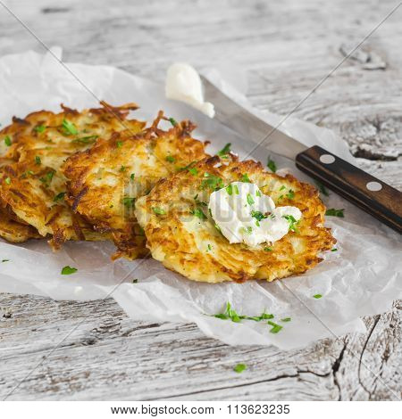Potato Pancakes Or Latkes On A Light Rustic Wood Surface
