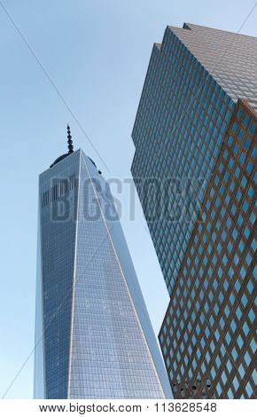 NEW YORK - SEPTEMBER 06: View from below of the top of the exterior glass facade of One World Trade Center built to replace Twin Towers at Ground Zero. September 06, 2015 in New York.