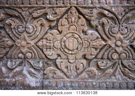 Vintage Style Carving Art On Stone Brick Wall
