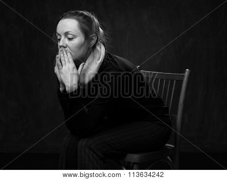 Young Sad Disoriented Woman Sitting On The Chair