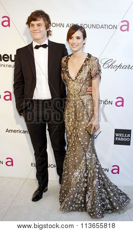 Evan Peters and Emma Roberts at the 21st Annual Elton John AIDS Foundation Academy Awards Viewing Party held at the West Hollywood Park in Los Angeles, USA on February 24, 2013.