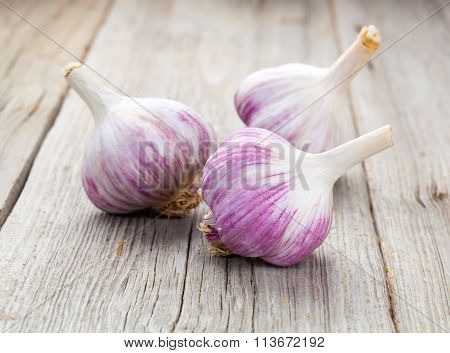 Organic Garlic Whole And Cloves On The Wooden Background