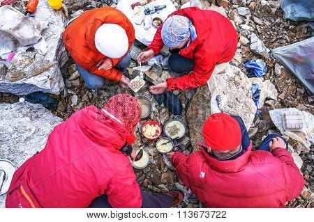 Group Of Tourists Takes Food On A Camp