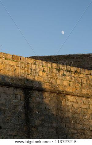 Walls And Moon At Sunset