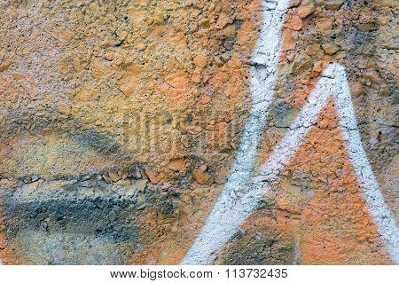 Orange Aged Wall Made Of Small Rocks