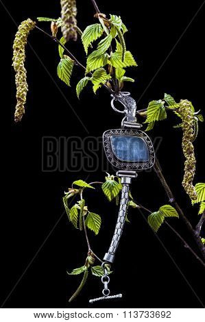 Vintage silver bracelet with blue agate on branch of birch