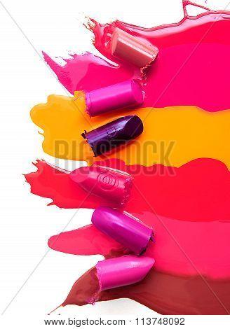 Six mudged lipsticks isolated on white background