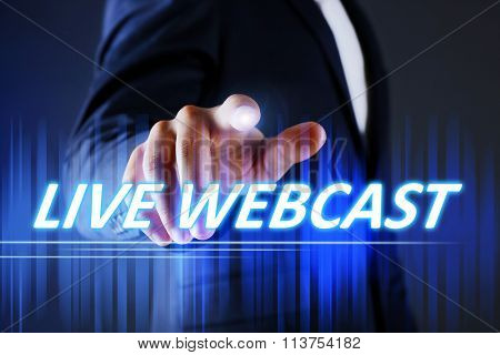 Businessman pressing live webcast button on virtual screen. Internet and networking concept.
