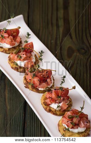 Potato pancakes with salted salmon and creme fraiche