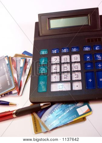 Credit Cards, Pens And Calculator