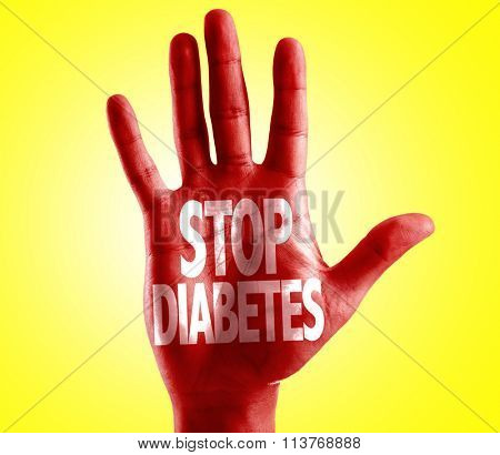 Stop Diabetes written on hand with yellow background