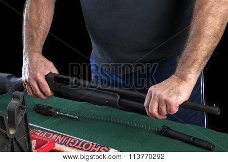 HAYWARD, CA - FEBRUARY 05, 2015: Gunsmith disassembling and reassembling a shot gun