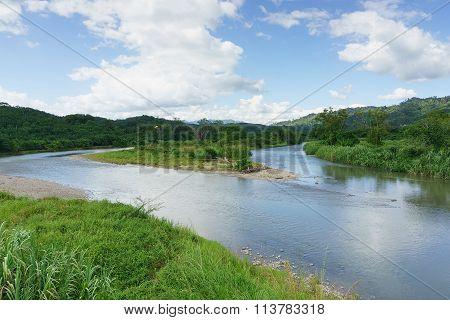 river confluence at Sabah Malaysian Borneo during cloudy blue sky.