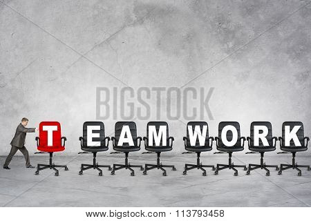 Young businessman pushing word team work