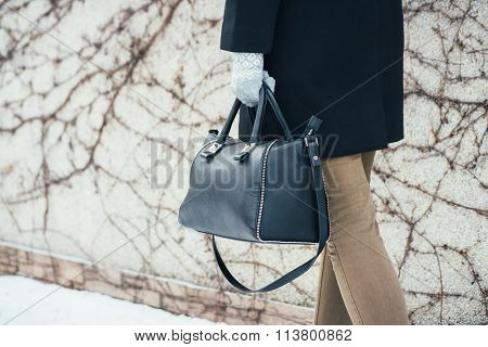 Woman In Winter Coat Walking On The Street With Handbags