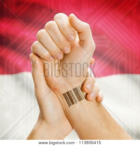 Barcode Id Number On Wrist And National Flag On Background - Monaco