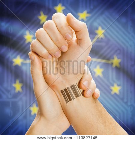 Barcode Id Number On Wrist And Usa States Flags On Background - Indiana