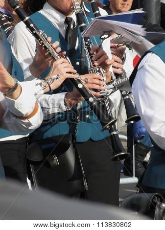 Clarinets In The Hands Of The Musicians In The Orchestra
