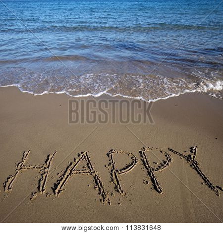 Word Happy Written On Sand