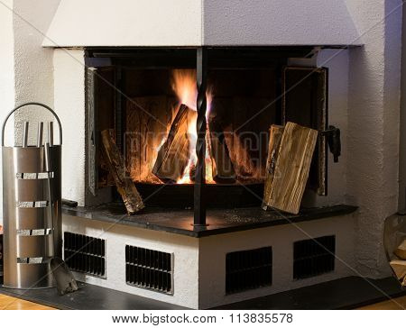 Fireplace inside home burning wood