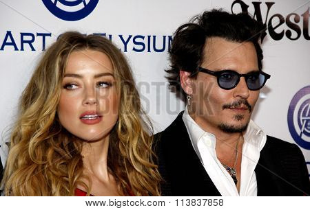 Amber Heard and Johnny Depp at the Art Of Elysium's 9th Annual Heaven Gala held at the 3LABS in Culver City, USA on January 9, 2016.