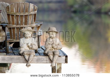 Figurines on the water