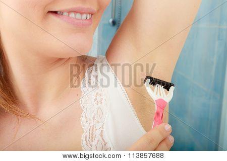 Woman Shaving Armpit With Razor Shaver. Hygiene.