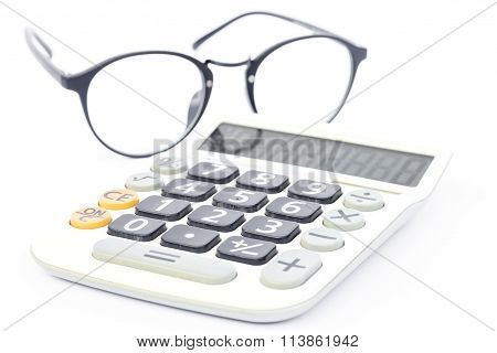 Calculator With Eyeglasses Isolated On White Background