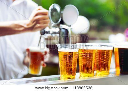 Man drawing beer