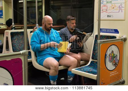 Participants Reading A Book On The Subway