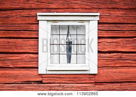 Old Window on Red Wooden Lumber House