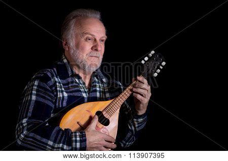 Bearded senior man with mandolin