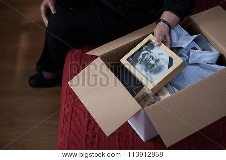Widow Packing Things Into Box
