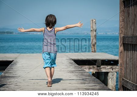 Happy child outdoor in nature on lake