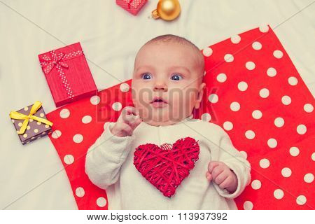 Little Baby With Heart Shape Toy