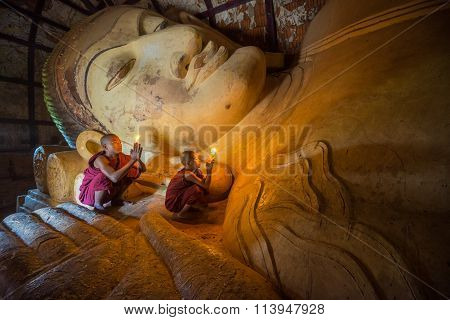 Unidentified Buddhism neophyte prays in Shinbinthalyaung Temple.