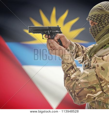 Male In With Gun In Hand And National Flag On Background - Antigua And Barbuda