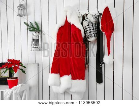 Santa suit on a white wooden wall